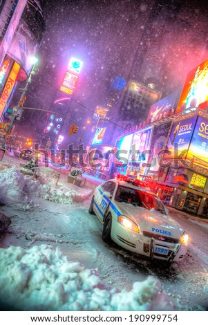 NEW YORK CITY - JAN 27: NYPD police car during first snowfall of the year in Times Square, New York City on Jan 27, 2011. - stock photo