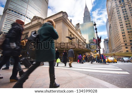 NEW YORK CITY - Jan 4: Rush of pedestrians outside historic Grand Central Terminal in NYC on Jan 4, 2013. The world's largest train station, Grand Central has more than 44 platforms and 67 tracks. - stock photo