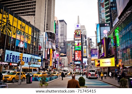 NEW YORK CITY - JAN 6: Times Square in the morning, features Broadway Theaters and is a symbol of New York City on January 6, 2011 in Manhattan, New York City. - stock photo