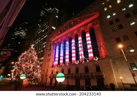 NEW YORK CITY - JAN 3: Wall Street New York Stock Exchange, the world's largest stock exchange by market capitalization, at night. January 3, 2009 in Manhattan, New York City - stock photo