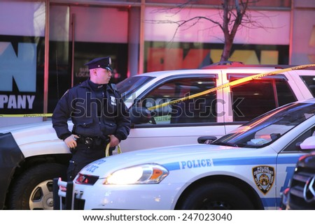 NEW YORK CITY - JANUARY 25 2015: a shooting at the Home Depot store in Chelsea left two employees dead in what is being called a murder-suicide. Officer guards vehicle possibly belonging to one victim - stock photo