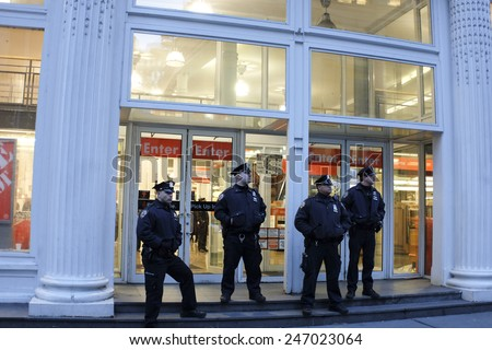 NEW YORK CITY - JANUARY 25 2015: a shooting at the Home Depot store in Chelsea left two employees dead in what is being called a murder-suicide. Uniformed NYPD officers in front of Home Depot - stock photo