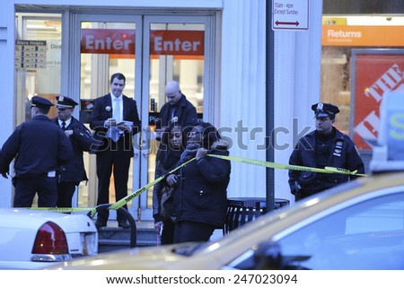 NEW YORK CITY - JANUARY 25 2015: a shooting at the Home Depot store in Chelsea left two employees dead in what is being called a murder-suicide. Shoppers present during shooting leave scene - stock photo