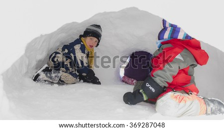 NEW YORK CITY - JANUARY 24 2016: Brooklyn kids inhabit makeshift igloo in Prospect Park, celebrating the end of winter storm Jonas, one of NYC's top five blizzards since records were kept
