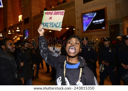 NEW YORK CITY - JANUARY 12 2015: Led by the Bronx Cop Watch, several dozen protesters gathered in Grand Central Terminal to protest against alleged acts of police brutality & lack of accountability - stock photo