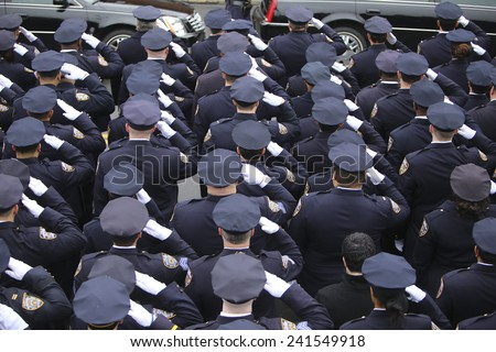 NEW YORK CITY - JANUARY 4 2015: several thousand police officers from all over North America attended funeral services for slain NYPD officer Wenjian Liu in Brooklyn - stock photo