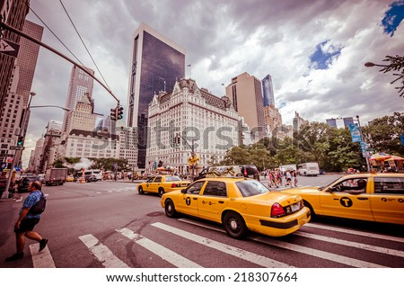 NEW YORK CITY - JUL 17: Grand Army Plaza in New York on July 17, 2014. Grand Army Plaza lies at the intersection of Central Park South and Fifth Avenue in front of the Plaza Hotel in Manhattan. - stock photo