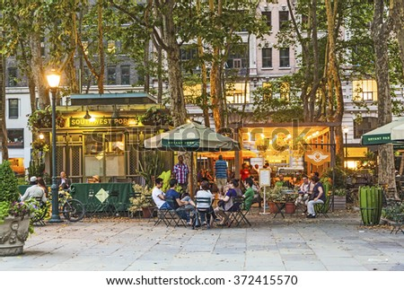 NEW YORK CITY - JUL 8, 2010: people enjoy the evening at Bryant Park in New York, USA. Bryant Park is a 9.603-acre privately managed public park located in midtown New York . - stock photo