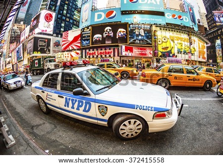 NEW YORK CITY - JUL 8, 2010: Times Square, featured with Broadway Theaters and guarded by police is a symbol of New York City and the United States in Manhattan, New York City. - stock photo
