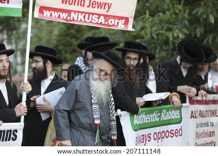 NEW YORK CITY - JULY 25 2014: ADULAH NY, a organization dedicated to divestiture from Israel staged a protest & march in Lower Manhattan against Israeli actions in Gaza. Neturei Karta members at rally - stock photo