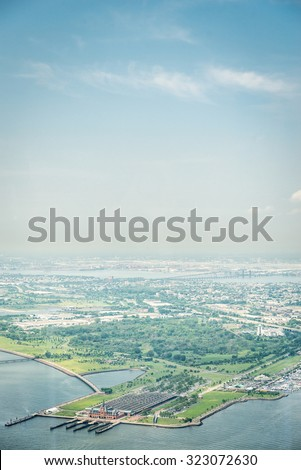 NEW YORK CITY - JULY 13: Aerial view on Liberty State Park on July 13, 2015 in New York. Liberty State Park is located on Upper New York Bay in Jersey City, New Jersey, opposite Liberty Island. - stock photo
