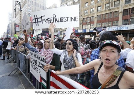 NEW YORK CITY - JULY 25 2014: Al Awda, an organization dedicated to the right of return for all Palestinians to Israel held a rally for Gaza in Times Square on Al-Quds day, the last Friday of Ramadan