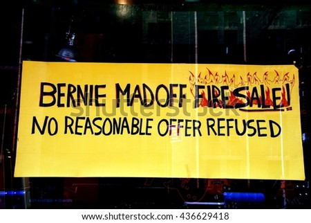 New York City - July 24, 2009:    Amusing Bernie Madoff fire sale sign in a guitar shop on West 23rd Street in Chelsea