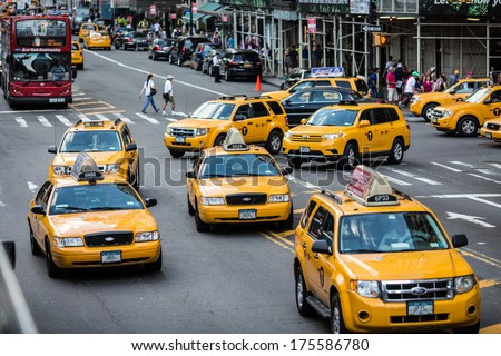 NEW YORK CITY - JULY 08: Busy traffic with yellow cab taxi cars on July 08, 2013 in Manhattan, New York City.   - stock photo