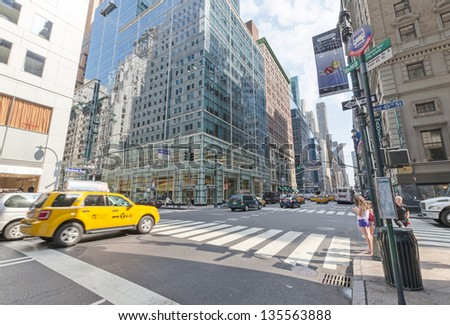 NEW YORK CITY - JULY 12: Cars drive down Madison avenue on July 12, 2012 in New York. Manhattan is a major commercial, economic, and cultural center of the United States. - stock photo