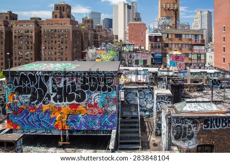 NEW YORK CITY - JULY 26, 2013:  Cityscape of lower Manhattan across graffiti covered buildings looking downtown.  - stock photo