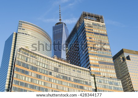 NEW YORK CITY - JULY 05, 2015: Downtown Manhattan skyline featuring the World Trade Center Freedom Tower beyond the eco-friendly residential Riverhouse development in Battery Park City.