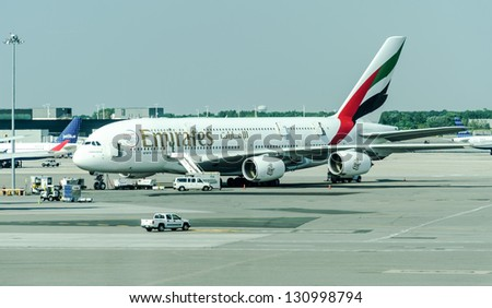 NEW YORK CITY - JULY, 15: Emirates Airbus A380 on JFK Airport on July 15, 2012 in New York. The Airbus A380 is a the world's largest passenger airliner. - stock photo