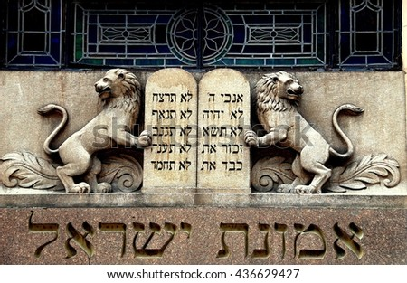 New York City - July 17, 2009: Lions of Judah flank Ten Commandments tablets above the entrance to Congregation Eumanath Israel on West 23rd Street in Chelsea