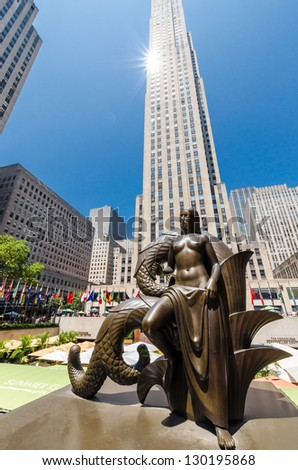 NEW YORK CITY - JULY 12: Maiden Statue near Rockefeller Center on July 12, 2012. Rockefeller Center is a complex of 19 commercial buildings covering 22 acres. - stock photo