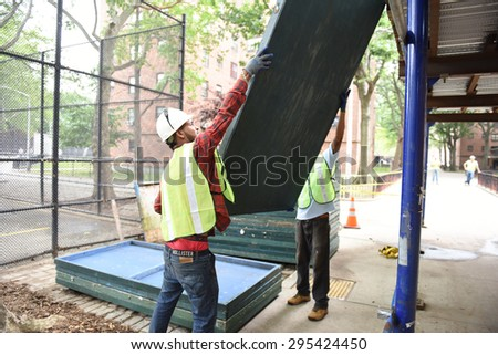 NEW YORK CITY - JULY 9 2015: Mayor Bill de Blasio hosted a press conference at the Sheepshead Houses to announce that NYCHA policy of removing sidewalk shedding in the absence of construction. - stock photo