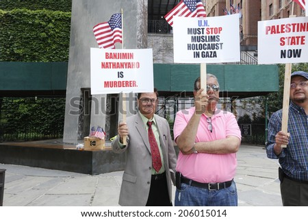 NEW YORK CITY - JULY 19 2014: More than a dozen Muslim-American men protested Israeli Prime Minister Benjamen Netanyahu & Israeli actions in Gaza in front of the United Nations building on First Ave
