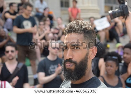 NEW YORK CITY - JULY 23 2016: More than one hundred activists braved scorching Brooklyn heat to rally at the Barclay's Center prior to marching through downtown Brooklyn to gather at Borough Hall.