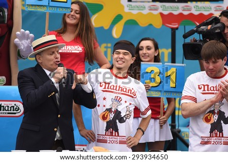 NEW YORK CITY - JULY 4 2015: Nathan's Famous held its annual fourth of July hot dog eating contest in Coney Island, Brooklyn. Promoter & MC congratulates winner Matt Stonie