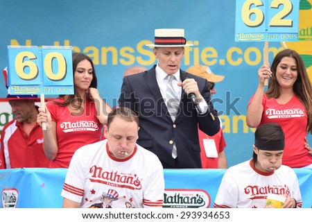 NEW YORK CITY - JULY 4 2015: Nathan's Famous held its annual fourth of July hot dog eating contest in Coney Island, Brooklyn. Matt Stonie & Joey Chestnut compete