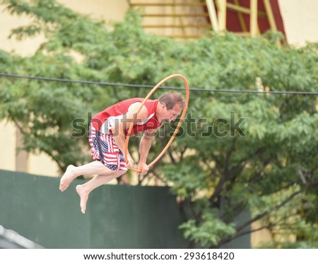 NEW YORK CITY - JULY 4 2015: Nathan's Famous staged its annual fourth of July hot dog eating contest in Coney Island, Brooklyn. Trampoline demonstration with hula hoop