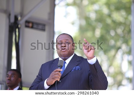 NEW YORK CITY - JULY 19 2015: National Action Network & SEIU members staged a rally to mark the anniversary of Eric Garner's death in Cadman Plaza, Brooklyn. Hakim Muhammed of the Nation of Islam - stock photo