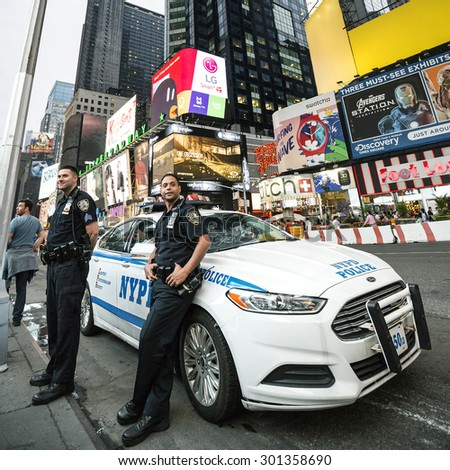 NEW YORK CITY - JULY 10: NYPD Police officers in NYC on July 10, 2015. The New York City Police Department (NYPD), established in 1845, is the largest municipal police force in the United States. - stock photo