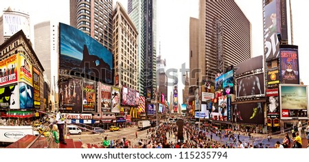NEW YORK CITY - JULY 20: Panoramic shot of Times Square, busy tourist intersection of neon art and commerce and is an iconicplace of New York City and USA on July 20, 2012 in Manhattan, New York City.