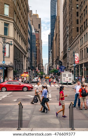 NEW YORK CITY - JULY 25, 2016: people on the streets of New York City. Many districts and landmarks in NYC have become well known, and the city received a record of nearly 60 million tourists in 2015