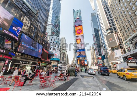 NEW YORK CITY - JULY 22: People visit Times Square on July 22, 2014 in New York. Times Square is a major commercial intersection in Manhattan, at the junction of Broadway and 7th Ave.