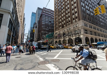 NEW YORK CITY - JULY 12: People walk down seventh avenue on July 12, 2012 in New York. Seventh Avenue is a thoroughfare on the West Side of the borough of Manhattan. - stock photo