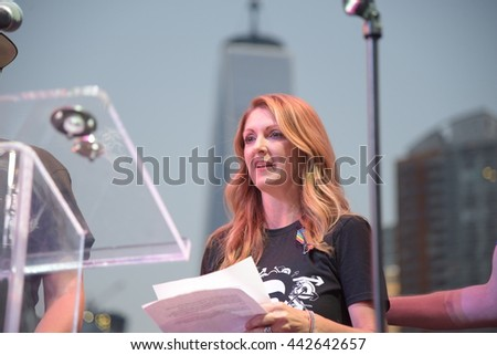 NEW YORK CITY - JULY 24 2016: Pulse nightclub owner Barbara Poma appeared at the Pride Rally on Pier 26 with entertainment  manager Neema Bahrami.