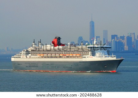 NEW YORK CITY - JULY 1: Queen Mary 2 cruise ship in New York Harbor heading for Canada and New England  on July 1, 2014 - stock photo