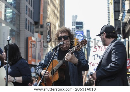 NEW YORK CITY - JULY 20 2014: several thousand supporters of Israeli actions in Gaza staged a rally in Times Square. Singer Ron Eliron (center) performs on stage flanked by Benny Elbaz (at right) - stock photo