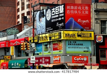 New York City - July 26, 2013:  Shops with signs in English and Chinese line the streets of Chinatown in Flushing (Queens)