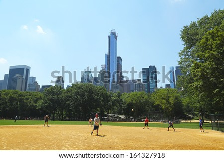 NEW YORK CITY - JULY 18:Softball teams playing at Heckscher Ballfields in Central Park on July 18, 2013.There are 26 softball and baseball fields open to the public in Central Park  - stock photo