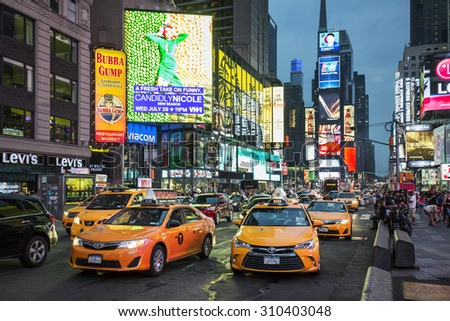 NEW YORK CITY - JULY 10: Taxi on Times Square, an iconic street of New York City and America, July 10, 2015 in Manhattan, New York City. Special photographic processing - stock photo