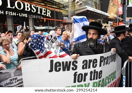 NEW YORK CITY - JULY 22 2015: thousands rallied in Times Square to oppose the President's proposed nuclear deal with Iran. Rally attendees angrily denounce Neturei Karta's anti-zionist stance