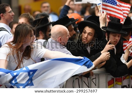 NEW YORK CITY - JULY 22 2015: thousands rallied in Times Square to oppose the President's proposed nuclear deal with Iran. Attempts to snatch Palestinian flags away from anti-zionist Neturei Karta