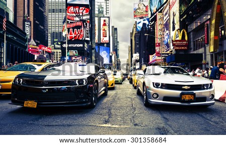 NEW YORK CITY -JULY 9: Times Square, featured with Broadway Theaters and animated LED signs, is a symbol of New York City and the United States, July 9, 2015 in Manhattan, New York City. USA. - stock photo