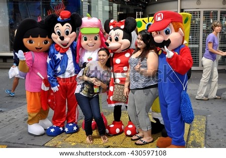 New York City - July 20, 2012:  Tourists pose for a photo with Disney's Mickey and Minnie Mouse and other characters from animated films in Times Square - stock photo