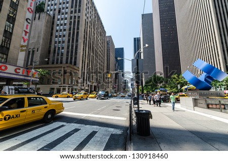 NEW YORK CITY - JULY 12:  Undefined people pass through Sixth Avenue on July 12, 2012 in New York City. Sixth Avenue is a major thoroughfare in New York City's borough of Manhattan. - stock photo