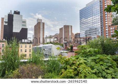 NEW YORK CITY - JULY 29,2014: View on Manhattan New York from High Line Park. The High Line is a public park built on an old railway track elevated above the streets of Manhattan. - stock photo
