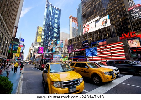 NEW YORK CITY - JULY 11: Yellow taxis on 7th Avenue in Times Square with crowds of people and lots of advertising on July 11, 2012 in New York, NY, US.