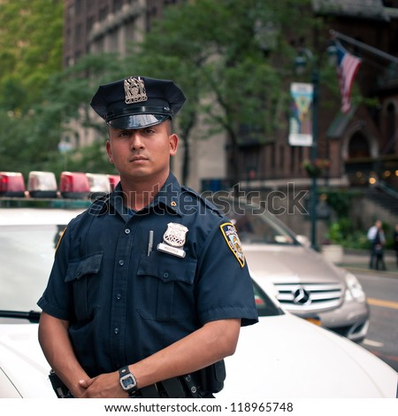 NEW YORK CITY - JUN 27: NYPD Police officer in NYC on June 27, 2012. The New York City Police Department (NYPD), established in 1845, is the largest municipal police force in the United States. - stock photo